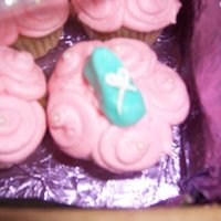 Baby Shoe Cupcakes  These were made for a very large baby shower that a friend was having last year. The shoes are made from a mold with fondant and tiny laces...