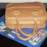 Purse Cake Made for a 16-year-old girl's birthday. Buttercream frosting - trim, keys, and cell phone are fondant and gumpaste.
