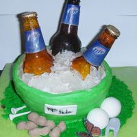 Sugar Beer Bottle Cake For my husband's 50th birthday. Completely edible - the bottles and ice are sugar. The golf tees, divot tool, and 19th hole sign are...