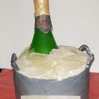 Champagne Bottle Cake Made for a 60th birthday. Champagne bottle and ice are made from sugar.