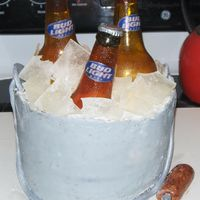 Beer Bucket Cake Bottles and ice are made from sugar.