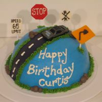 Road Signs Cake Buttercream cake with MMF street and signs. (car is plastic)