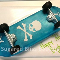 Skull And Crossbones Skateboard Half white and half chocolate cake filled with chocolate mousse and iced in american buttercream icing. Covered in fondant airbrushes in...
