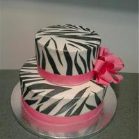 Zebra Stripes With Pink Ribbon butter cream iced cake with black fondant zebra stripes and pink grosgrain ribbon