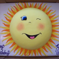 Sunshine 14 inch round cake Red Velvet with Cream Cheese Icing and covered in Fondant. The sun rays are cut and brushed with piping gel and then...