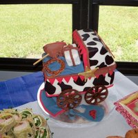 Cowboy Baby Carriage Red Velvet and White Cake with Cream Cheese icing and covered in fondant