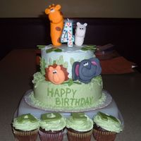 Safari Cake  Another cake inspired by the other safari cakes on this website. The birthday boy loved it! Oh and I didn't place the animals in the...