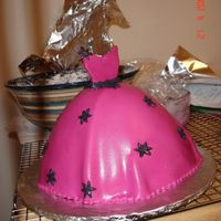 Dress Cake made this for a friends birthday. chocolate chip cake with a fresh raspberry butter cream covered with fondant. It's the most I'...
