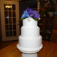 Round Wedding Cake buttercream icing and silk flowers