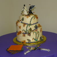 Fall Fairy Wedding Cake   topsy turvy cake with buttercream icing and fondant accents.