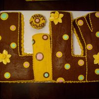 Lily's Birthday Cake for my niece's 5th birthday. The party theme was polka dots and her favorite color is yellow. Letters cut from chocolate cake (...