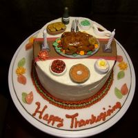 Thanksgiving Dinner Cake for my sister and her in-laws. Pumpkin Spice with cream cheese icing. All pieces of dinner, table runner and leaves made of fondant....