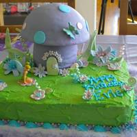 Evie's Tinkerbell Forest Tinkerbell cake for my neice's 3rd birthday. All flowers and decorations fondant except for plastic Tinkerbell figure. Main cake iced...