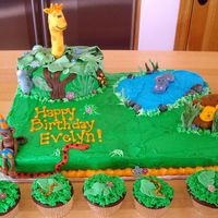 Jungle Animal Birthday Giraffe, Monkey, Elephant Trunk, Hippo, Lion & Snakes, Flowers, Leaves & Tree Trunks made from fondant. Cake iced in buttercream....