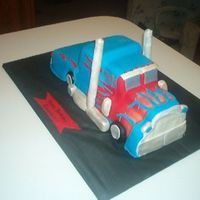 Optimus Prime I sculpted this out of pound cake that I baked using three 9x 5 loaf pans and covered with fondant.