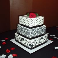 Black And White Transfer Wedding Cake This is my first square wedding cake. This was based on a pic of a cake the bride had found ina David's Bridal catalogue. The side...