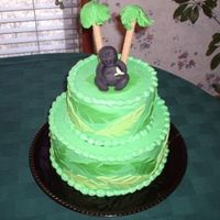 Gorilla Cake This was for my brother's birthday. He loves gorillas. It's a 6 i nch and 9 inch red velvet and lemon. The palm tree trunks are...
