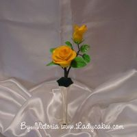 Yellow Rose Gumpaste yellow rose.. Entered this in to our county fair for a sugar art..