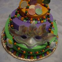 Mardi Gras - Fair Cake This is the cake that I am turning in for our County Fair the theme is Mardi Gras so this is what I came up with .. The mask is made out of...