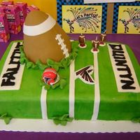 Crashing Football Cake This cake design was based off of one I saw right here on Cake Central. The football was made out of rice Krispies so it would keep it&#039...