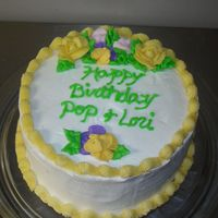 Poploricake.jpg Birthday cake for my Grandpa and Aunt. White cake with strawberry swirl. Vanilla buttercream frosting and flowers. Thanks for looking.