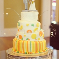 Topsy Turvy Citrus Wedding Cake  6-8-10-12 rounds covered in buttercream with fondant accents. Bobblehead topper was ordered online with the couple. They were having a...