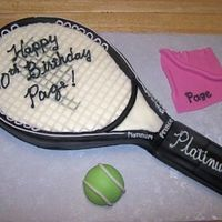 Tennis Racket Cake Carved from 1/4 sheet. Covered with MMF and black Satin Ice fondant. Buttercream details painted with Luck's silver airbrush color....