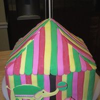 "Circus Tent For 1st birthday to match invitations. Carved from 4 8"" squares and 1 6"" square. Wasnt sure about carving the top, but it worked..."