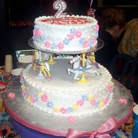 Merry Go Round Birthday Cake  I made this cake for my daughters 2nd birthday. Bottom cake was vanilla with dulce de leche filling, top layer was carrot cake filled with...