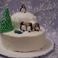 Penguin Winter Scene Cake that I made for a holiday party. Base is yellow cake with lemon filling and igloo is eggnog holiday confetti cake. Penguins and igloo...