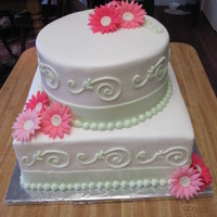 Mixed Shape Bridal Shower Cake With Gerbera Daisy 2 tier cake I made for a bridal shower with gerbera daisy theme. iced in almond buttercream with fondant ribbon and gerbera daisy.
