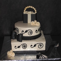 "Black And Ivory Bridal Shower Cake this cake was made for a ""shopping in New York"" themed bridal shower. Buttercream frosting in ivory and black with fondant duff..."