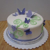 Purple Butterfly Birthday Cake iced in buttercream, fondant butterflies and ribbon