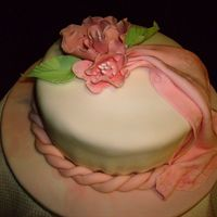 Brenda_012.jpg rolled fondant cake and drape with gumpaste flowers