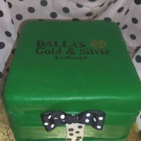 Dallas Gold And Silver Gift Box Gift box rum cake with pineapple filling. MMF frosting. The bow is of fabric. There was an actual wedding ring hidden inside the cake for...