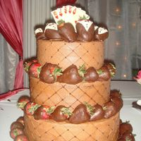 Tn Groom's Cake Chocolate Kahlua Cake w/ chocolate buttercream w/ over 50 chocolate covered strawberries. First official groom's cake.