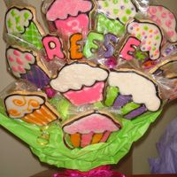 Reese 3Bd Cookie Bouquet NFSC w/ Toba's glaze.My first time using Toba's glaze and it taste pretty good. My first time w/ cupcake cookies. After seeing...