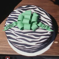 Teen Zebra Birthday Cake With Bow Zebra birthday cake with green bow, covered and decorated in fondant