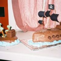 Black Pearl Pirate Ship Black Pearl Pirate Ship and island. Ship is chocolate MMF. Island is covered with Chocolate buttercream.