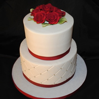 Red & White Wedding Small, simple wedding cake with roses and Diamond impression. Buttercream iced with ribbon.