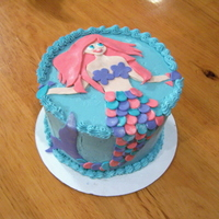 Mermaid Rainbow Cake The inside of this cake is 6 layers, each a different color of the rainbow (shown in another photo of the cake). French meringue...