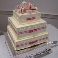 Pink And White Bow Cake French buttercream with cloth ribbons and fondant bow topper.