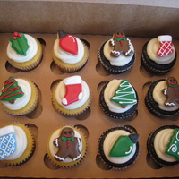 Christmas Cupcakes Mini sugars cookies serve as decorations for these Christmas cupcakes. Yellow and Chocolate cupcakes with vanilla buttercream icing.