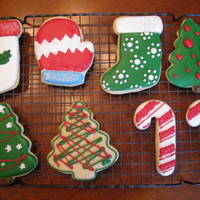 Natalie's Christmas Cookies Just wanted to share the cookies my 13 year old daughter made for Christmas this year. This was her first time decorating sugar cookies.