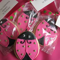 Ladybug Cookies Inspired by merissa. These were done in pink/green to match the birthday girl's invitations. Sugar cookies with Antonia74 royal.