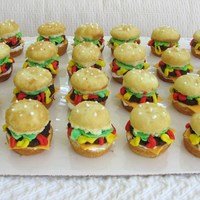 Hamburger Cupcakes Very fun to do! Cupcakes split in half with smashed up brownies for the patty. Condiments are buttercream icing and the cheese is fondant....