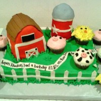 Farmyard Cake 9x13 sheet cake with barn, silo and animal cupcakes. Silo is cake baked in a soup can, bard was carved from a cake cooked in a loaf pan....