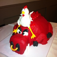Chicken Riding A Razorback  This was a groom's cake for a guy who loves the Arkansas Razorbacks & works at Tyson!! The chicken is gumpaste & the hog is...