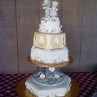 Country Wedding Cake $ tiered cake , with top 3 tiers stacked on top of glass bowboy boots. I think someone else on cc did this design first. Sorry I don't...