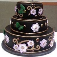 Butterfly Wedding Cake Cake for az cake show, I did not win , but I thought it was pretty. Black fondant with gold accents, and sugar butterflies, fondant flowers...